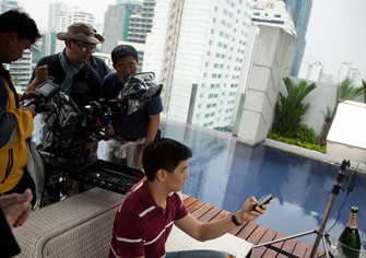 In a Thai high rise, the crew is pushing into a close up for Thai telephone communication