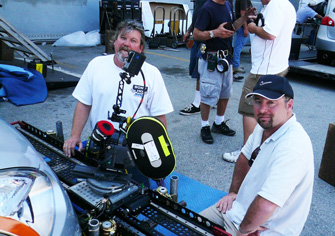 Key grip Greg Mustin and cinematographer Jeff Cronenweth, ASC, use a Motorized Slider to set up a self-contained car rig to slide across the car's front badge.